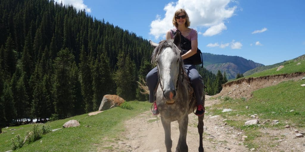 Woman riding a horse in Kyrgyzstan