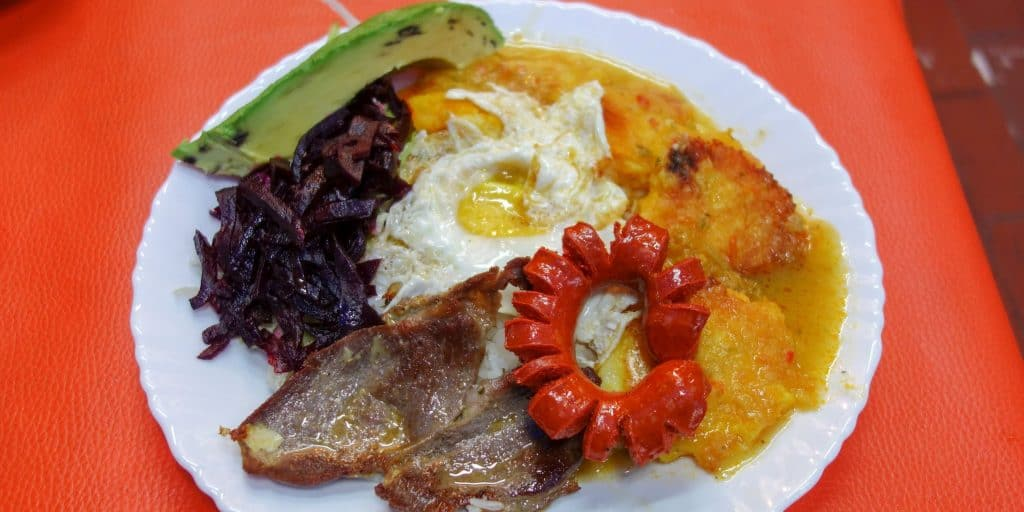 Llapingachos with sausage, egg and avocado, typical food in Ecuador