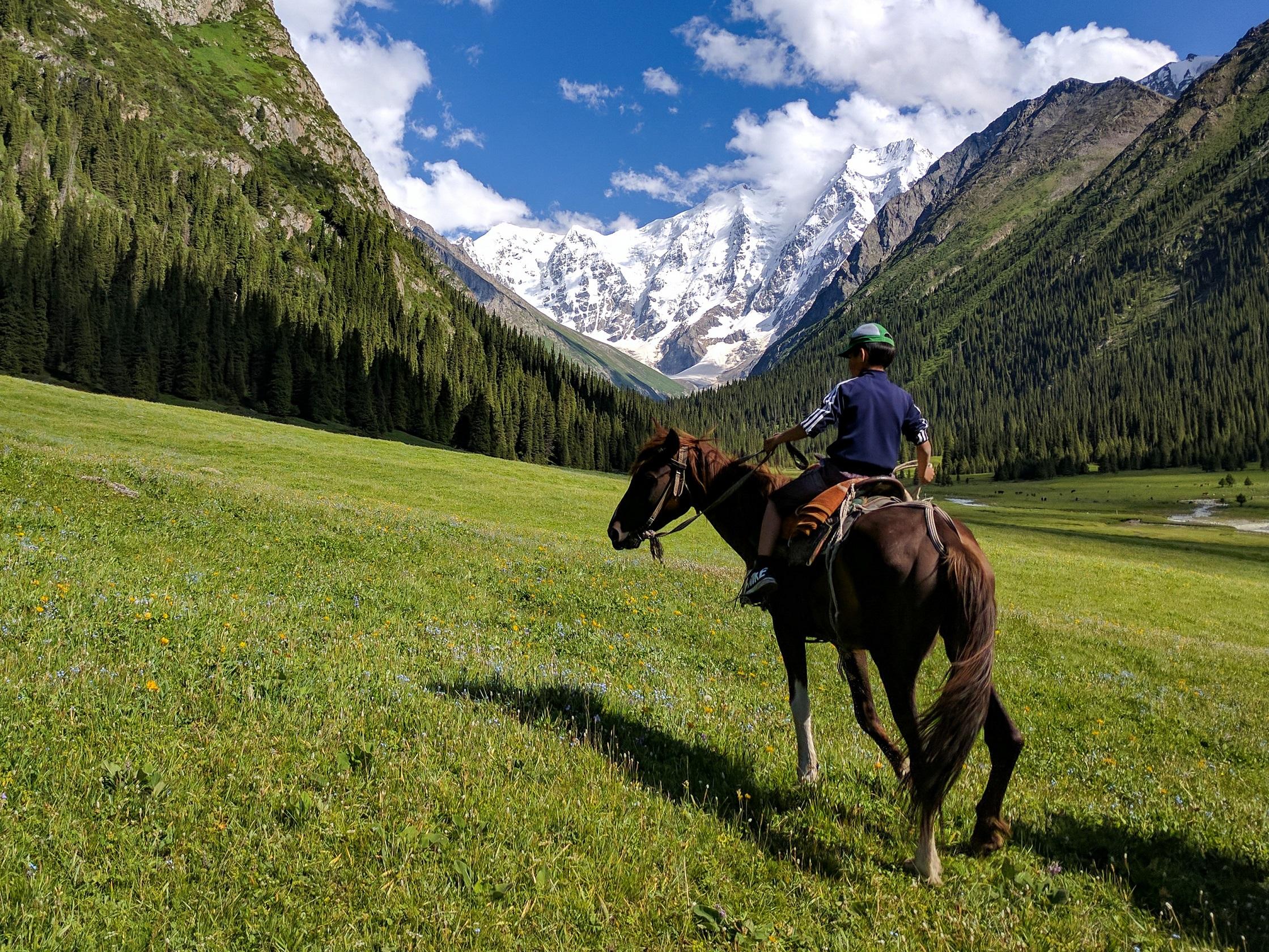 Boy on a horse in Kyrgyzstan