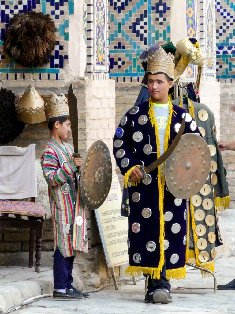 Two Uzbek boys wearing a traditional outfit in Samarkand, Uzbekistan