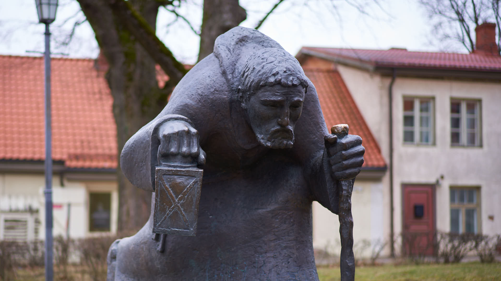 Statue of Old Man of Time in Cesis, Latvia