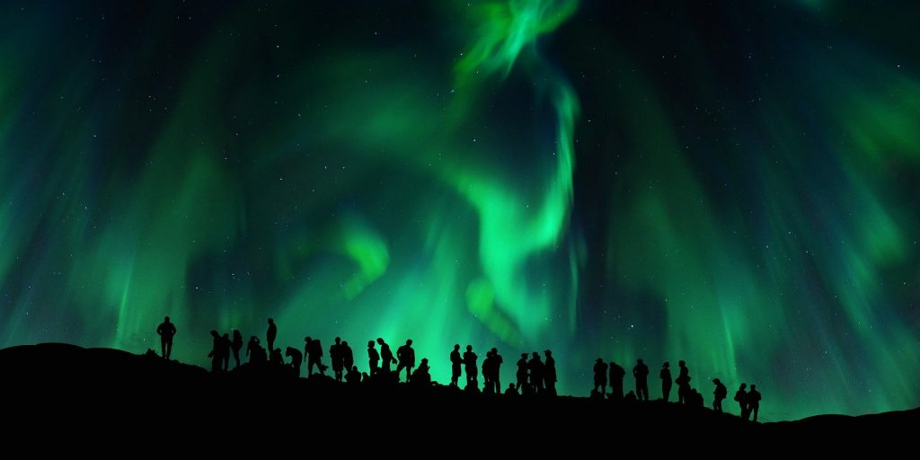 People watching the Northern Lights
