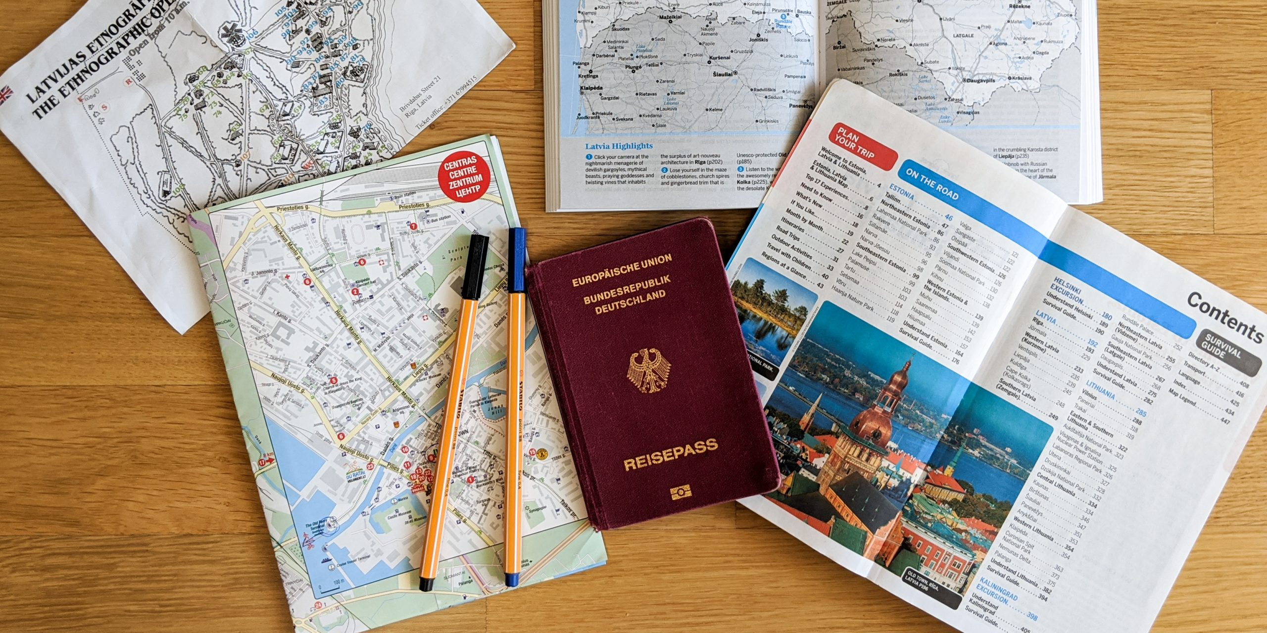 Travel Research documents, maps and a passport