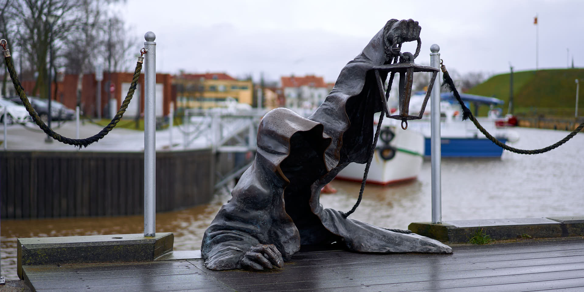 Black ghost statue in the harbour of Klaipeda