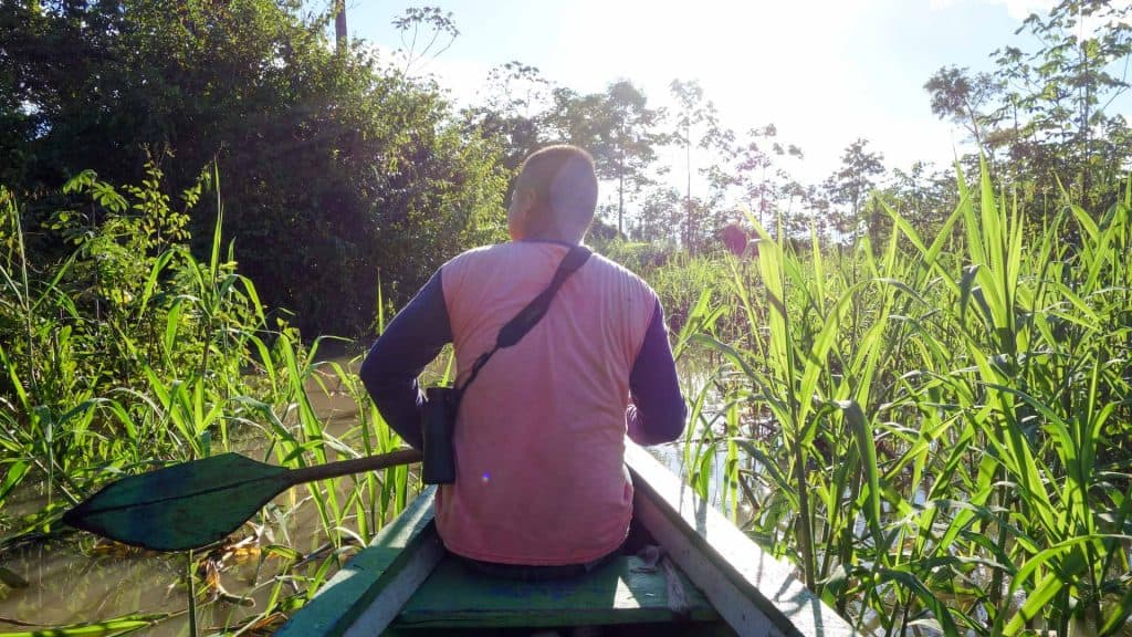 Tour guide in the Peruvian Amazon in a canoe