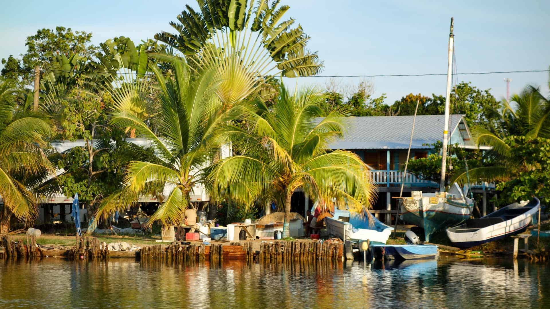 Houses on the riverside near Placencia, Belize