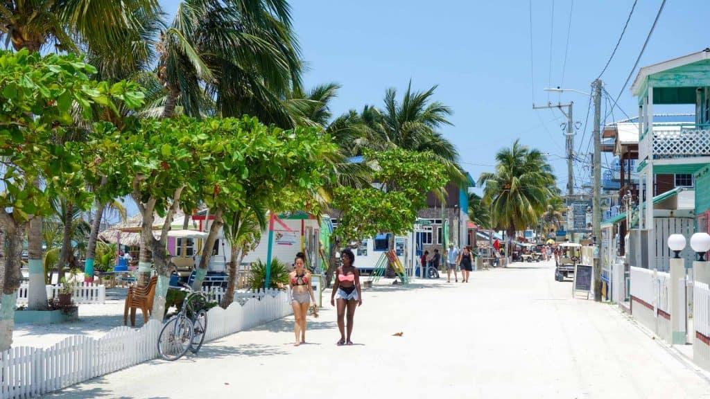 People walking on a road in Caye Caulker, Belize