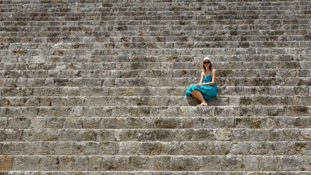 Ilona sitting on the stairs of a temple in Uxmal
